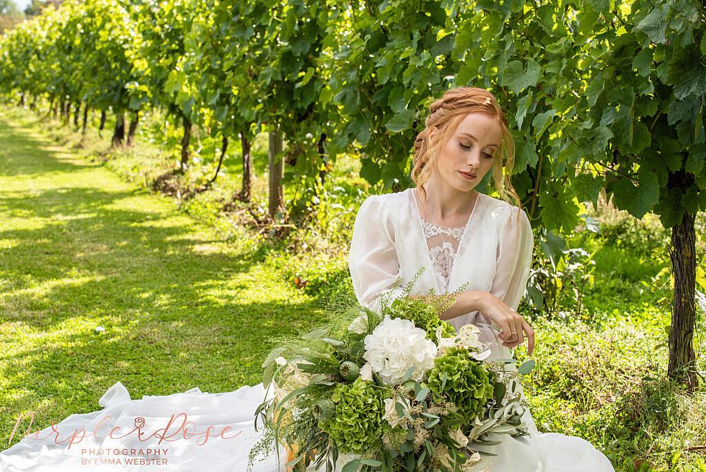 Bride sat with her bouquet