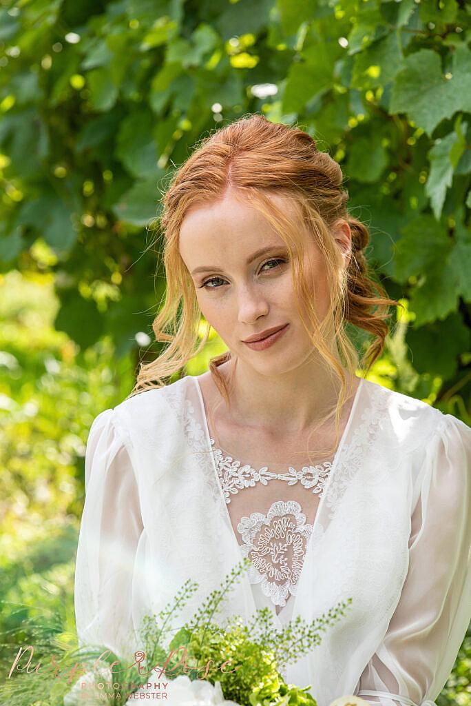 Bride sat in vineyard