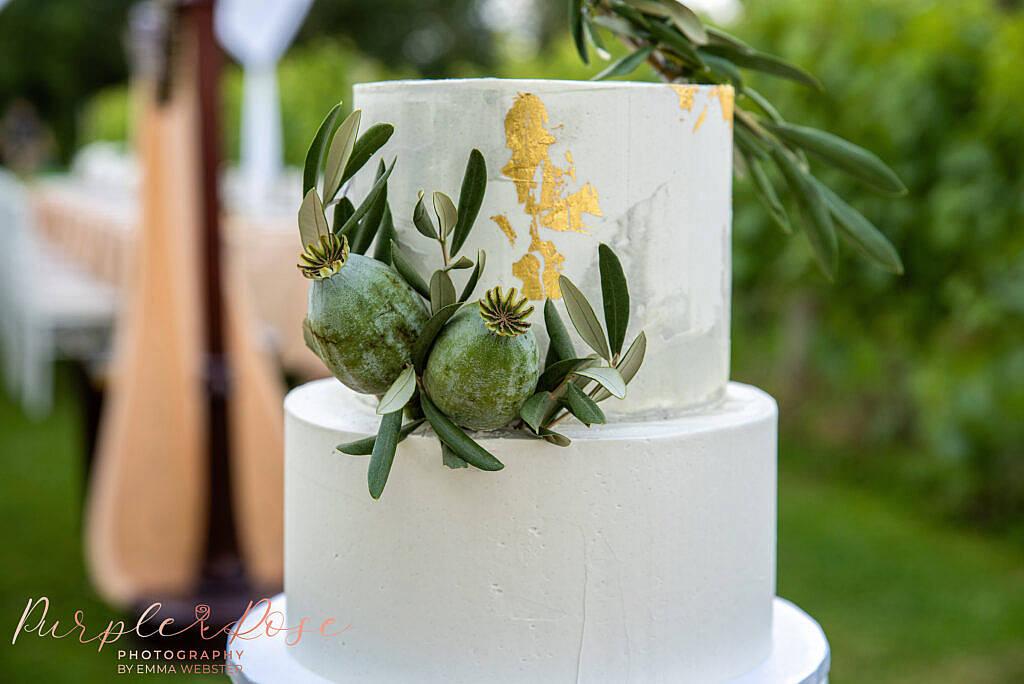Wedding cake decorated with foliage