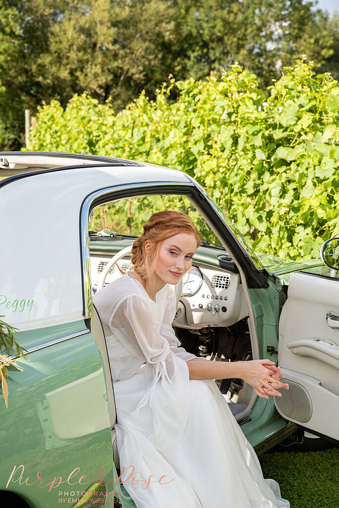 Bride leaning out of car