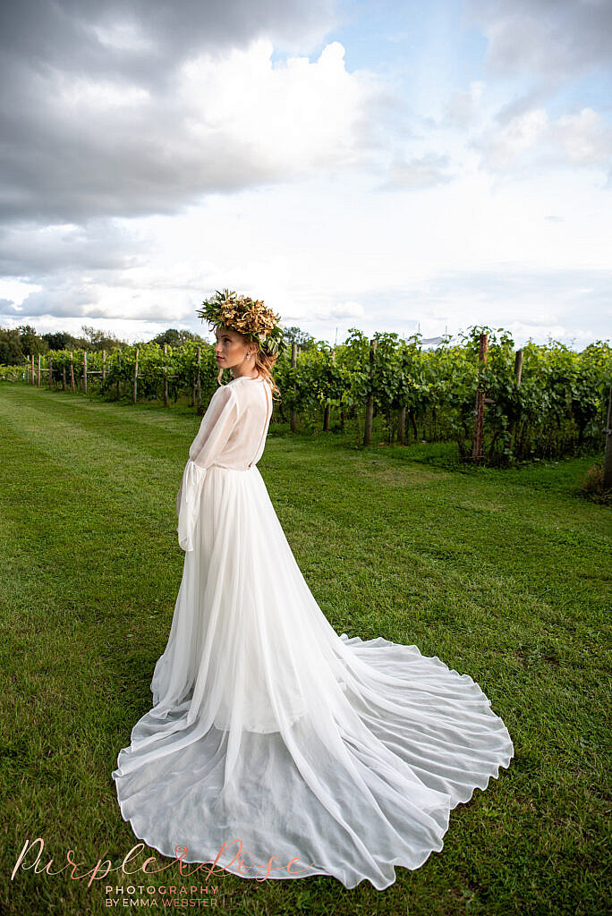 Brides gown flowing behind her