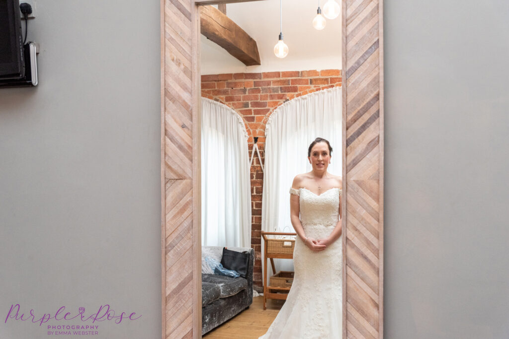 Bride checking her reflection in a mirror