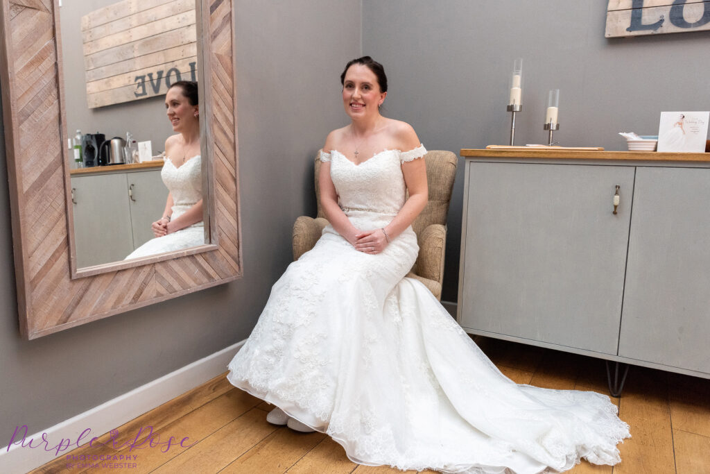 Bride sat in a chair by a mirror