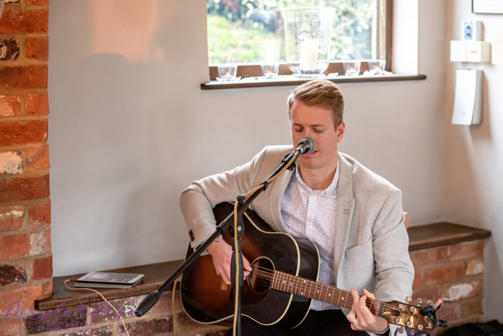 Professional wedding signer, singing and playing guitar