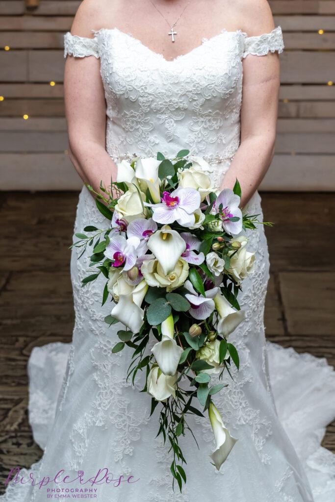 Close up of brides orchid wedding bouquet