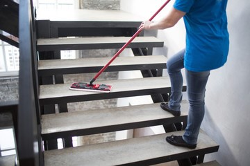 Woman Mopping Stairway