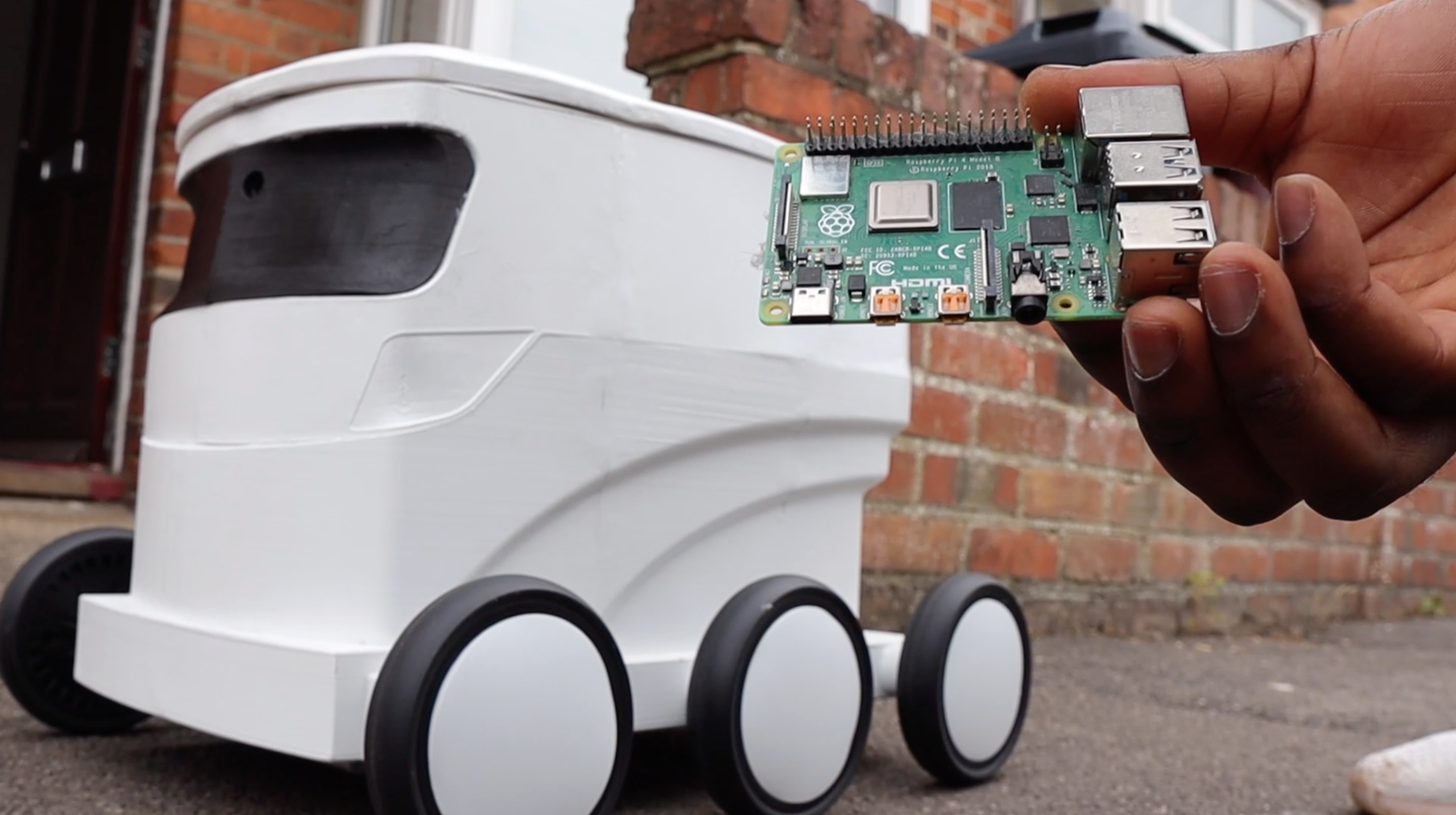 Building a Rapberry Pi Package Delivery Robot Controlled by Live Chat