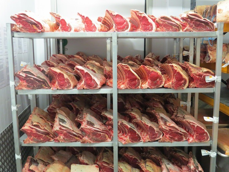 Image of beef maturing on a shelf at Campbells prime meats factory.