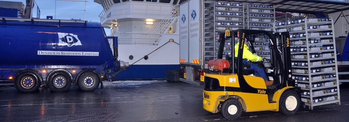 Image of forklift and lorry on site at Denholm Seafoods.