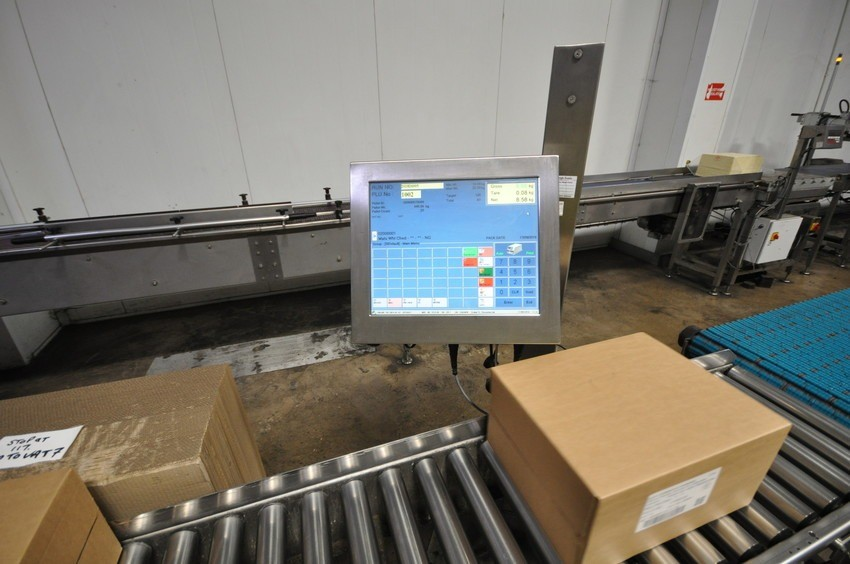 Image of cheese packaging and labelling process at SCC.