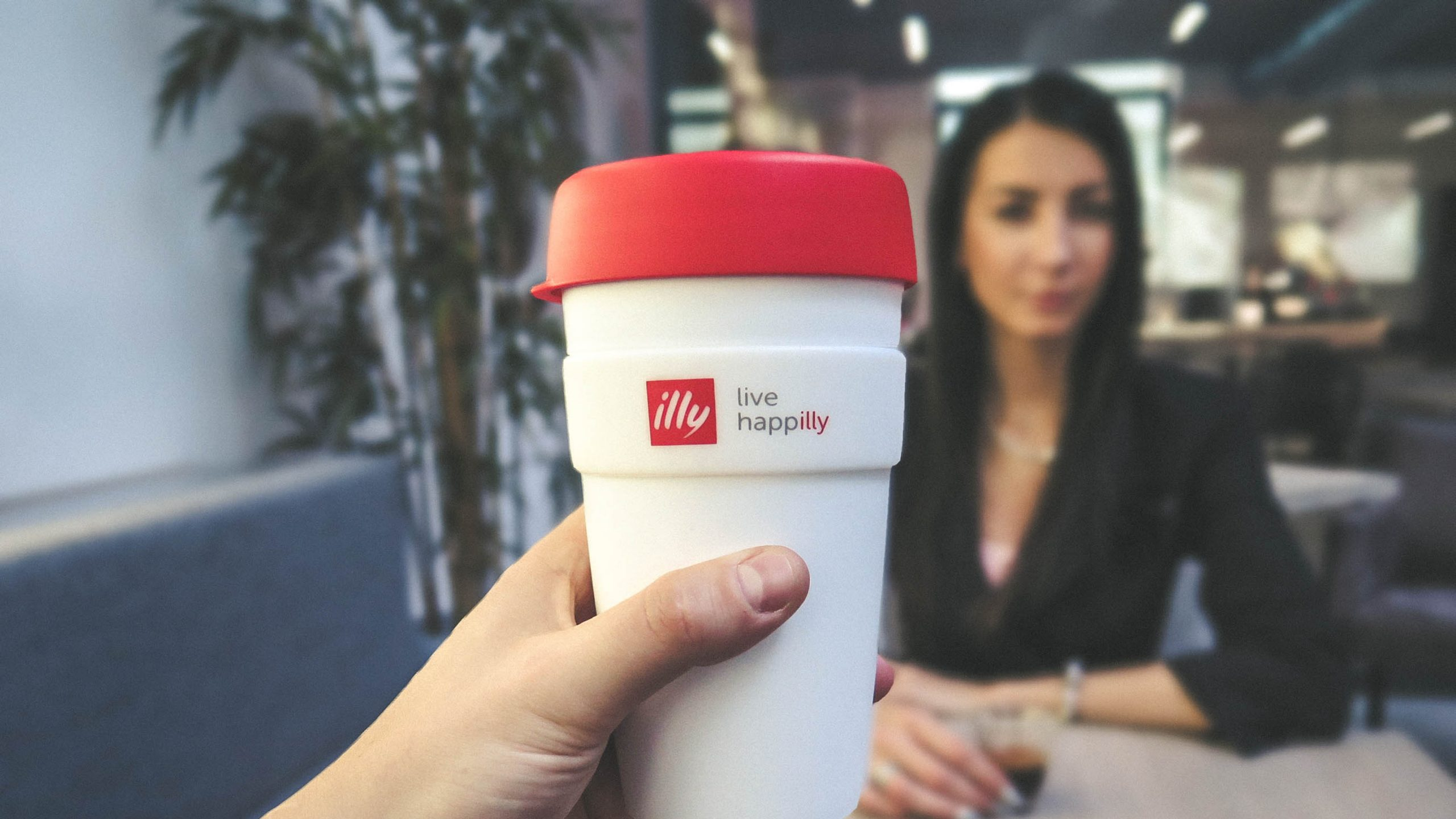 person-holding-white-and-red-live-happilly-cup-216489-scaled.jpg