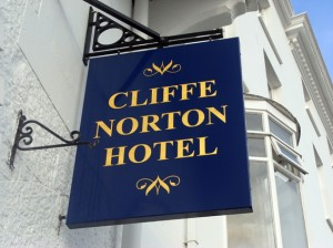 Projecting sign, swing sign, signage, tenby