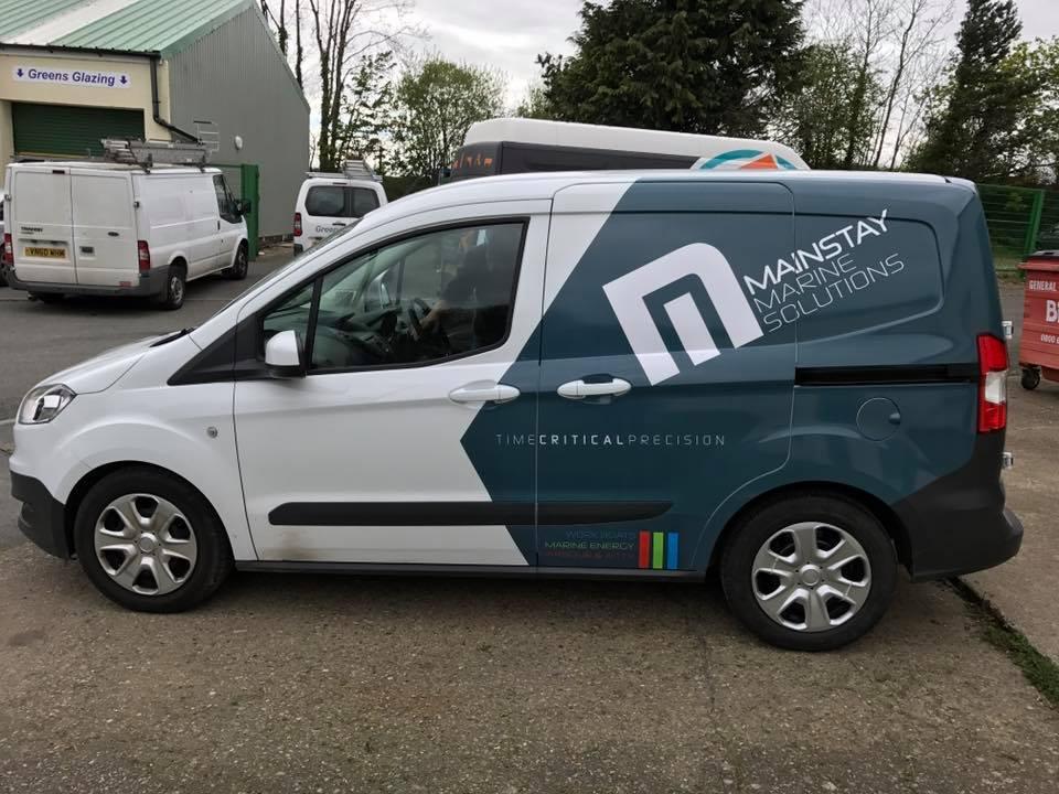 Vehicle wrap, vehicle graphics, van signs