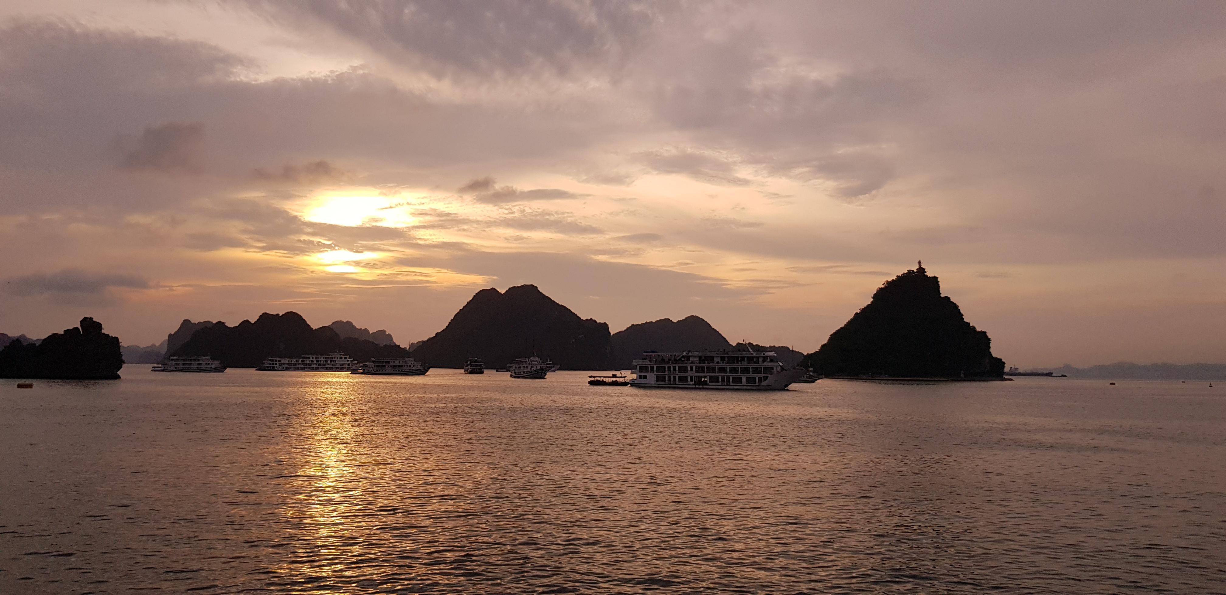 The sun setting over Ha Long Bay.