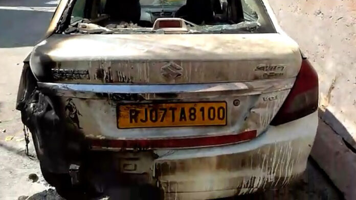 When refused to walk on Ajmer, They set the car on fire, beat the driver