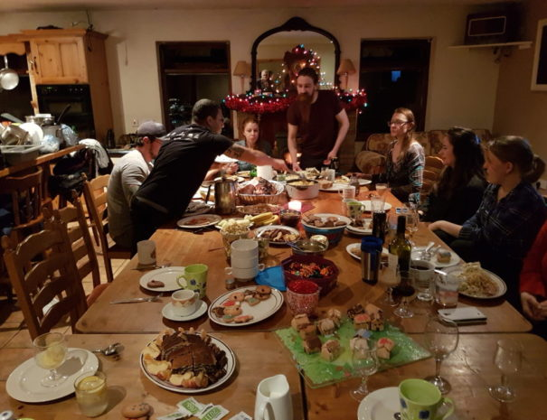 A group of guests we have over Christmas enjoying some home baked gingerbread and food