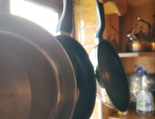 pans hanging in the window, showing the cooking facilities offered in our shared kitchen