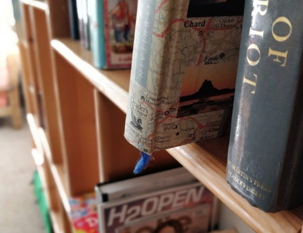A picture featuring a close up of one of the many book shelfs laid about