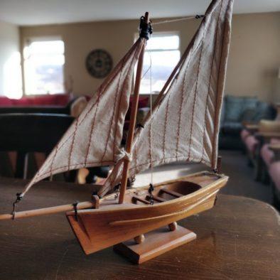 A small wooden boat ornament