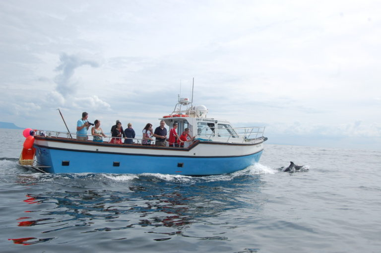 group of guests on a local boat tour of Slieve League cliffs
