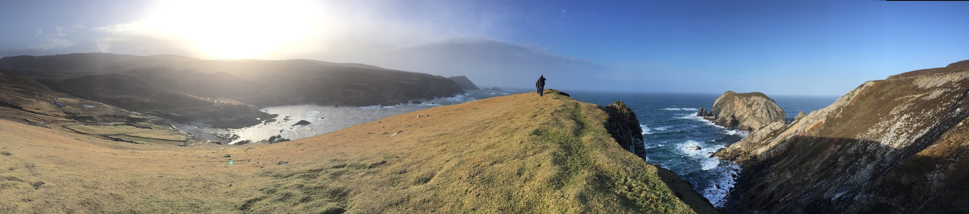 A scenic panoramic photo of a hillside dropping into the ocean at Port in Donegal