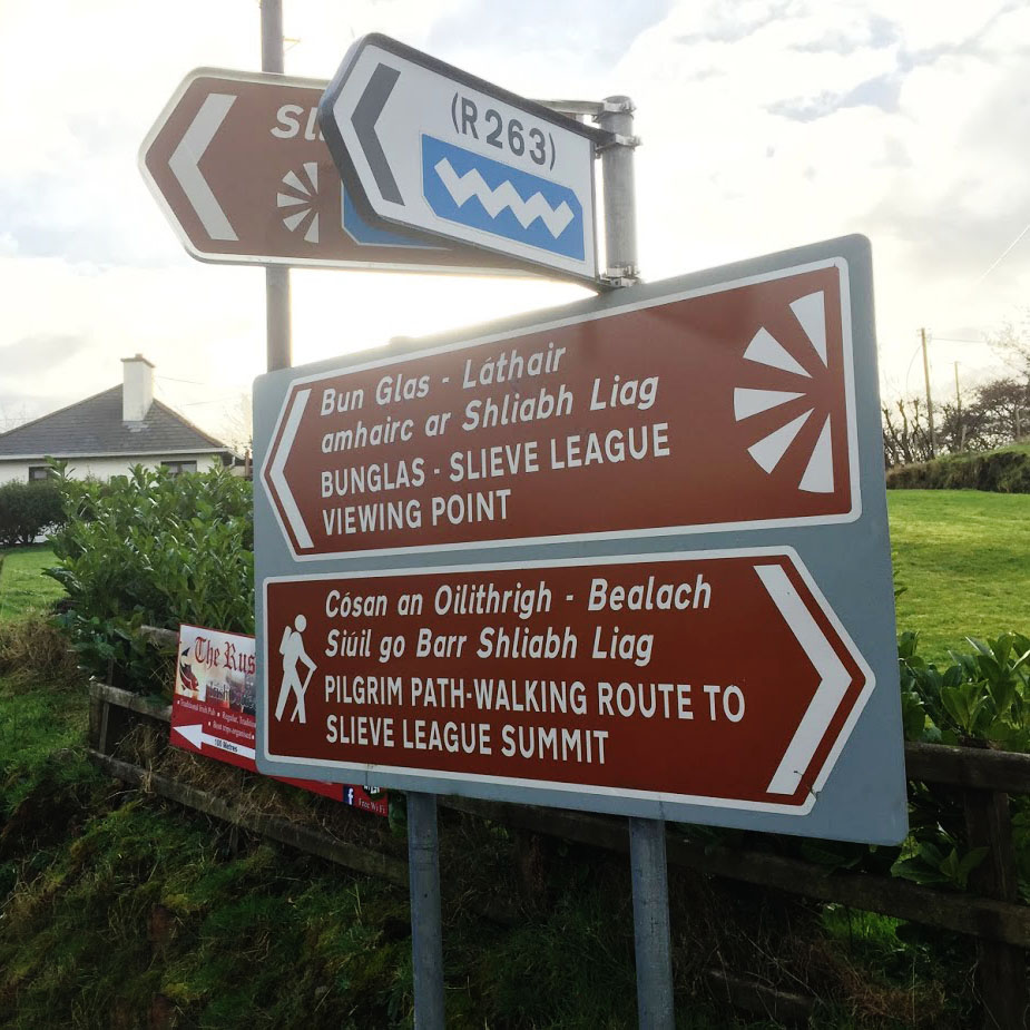 The sign post showing where to turn to to the right in order to reach the Pilgrims Path. This turn is just before the 'Rusty Mackerel' pub.