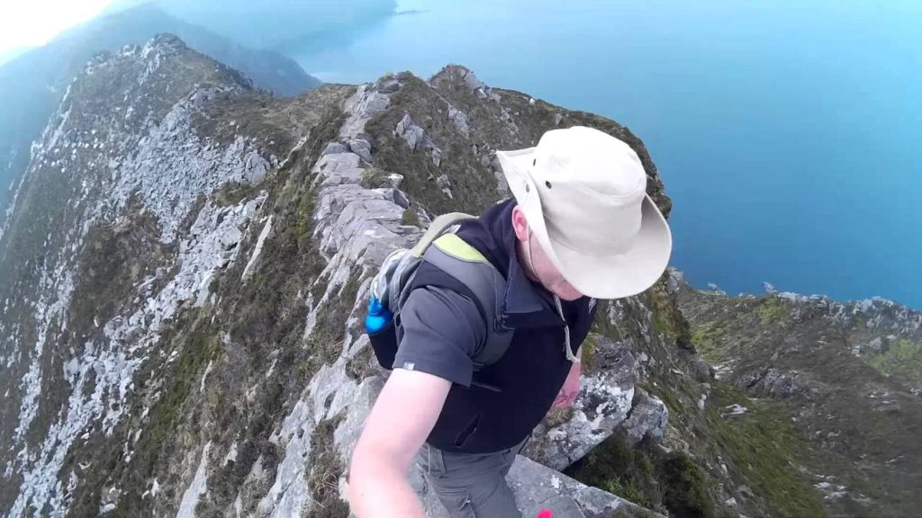 Man hiking the top of One Mans Pass