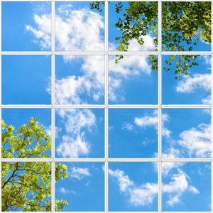 Large artificial skylight with several tiles featuring clouds and leaves