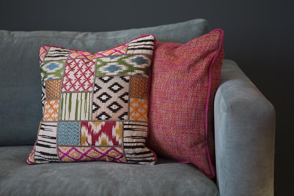 plumped cushions on sofa