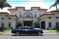LIMOUSINE IN FRONT OF LARGE MANSION COSTA RICA