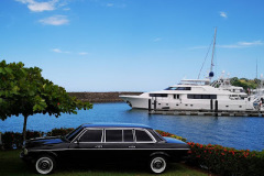 LOS SUENOS MARINA. MERCEDES 300D LIMOUSINE AND COSTA RICAN YACHT.