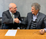 Ascend Performance Materials CEO Phil McDivitt and D'Ottavio Group president Giancarlo D'Ottavio sign deal for the acquisition of Poliblend and Esseti Plast GD