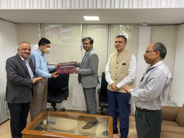 Signing of the MOU between officials of NTPC, NVVN, and Greenko Energies.