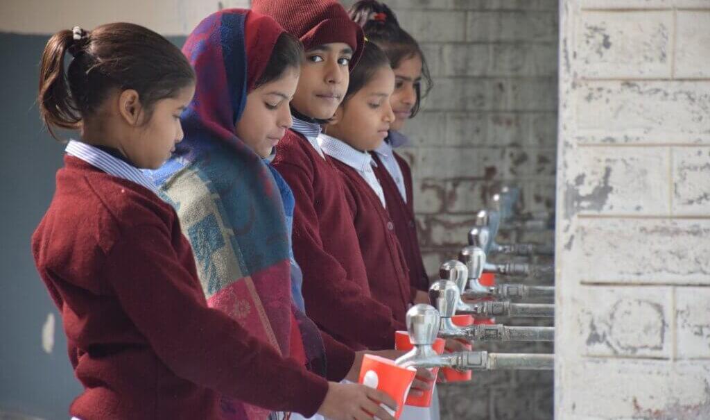 school children getting drinking water