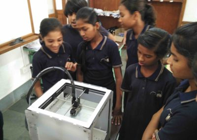 Avasara Students seeing the 3D printer work