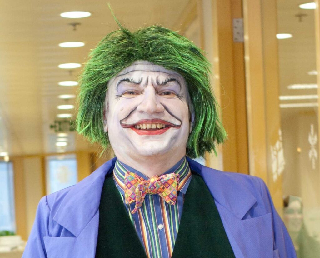 shows author / writer dressed as the Joker