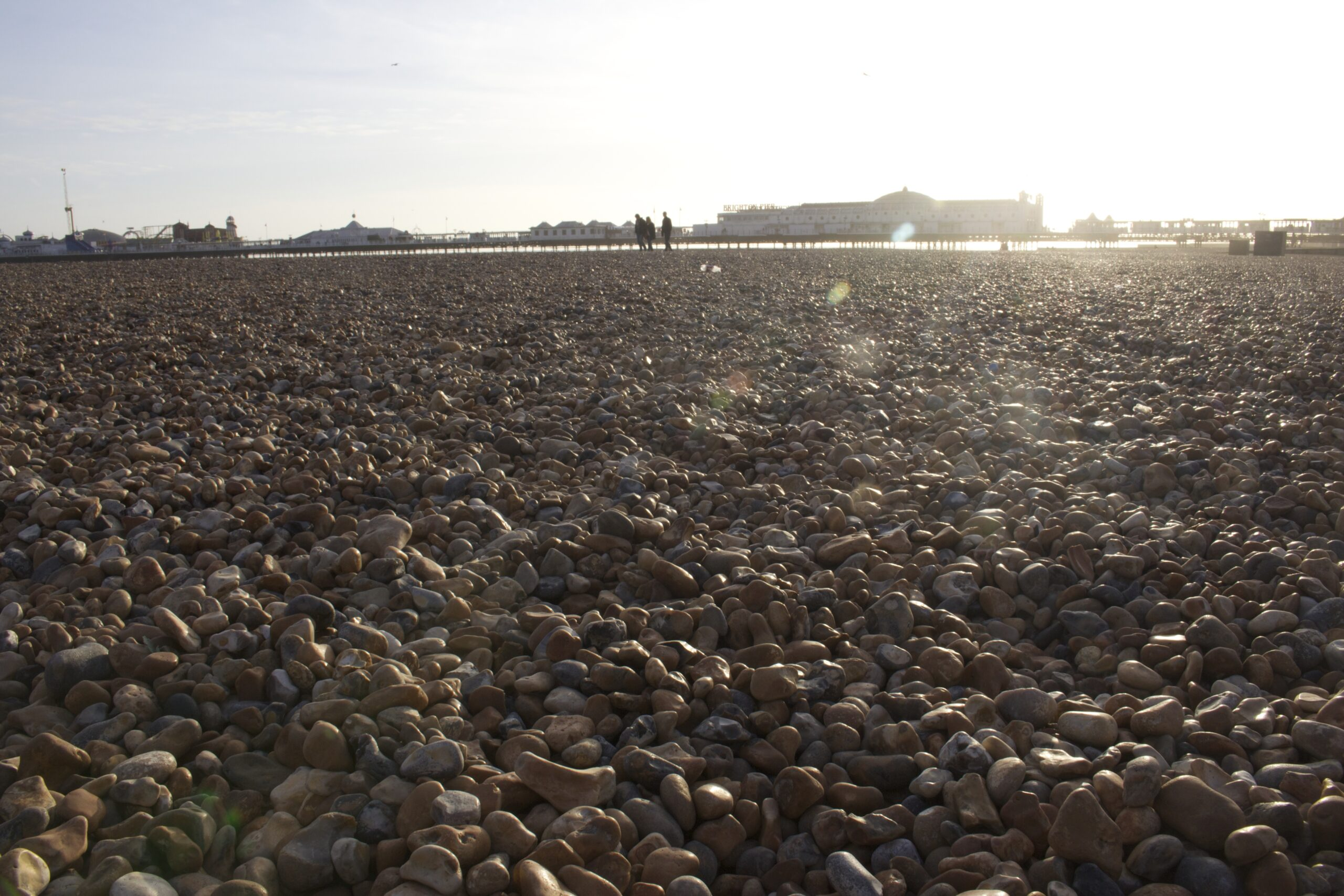 Brighton Pier across the pebbles