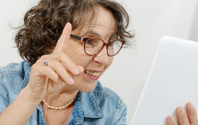 A woman in an online focus group with her hand up