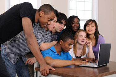 students watching a video on a laptop