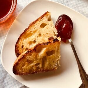 two slices of rustic no-knead bread with jam