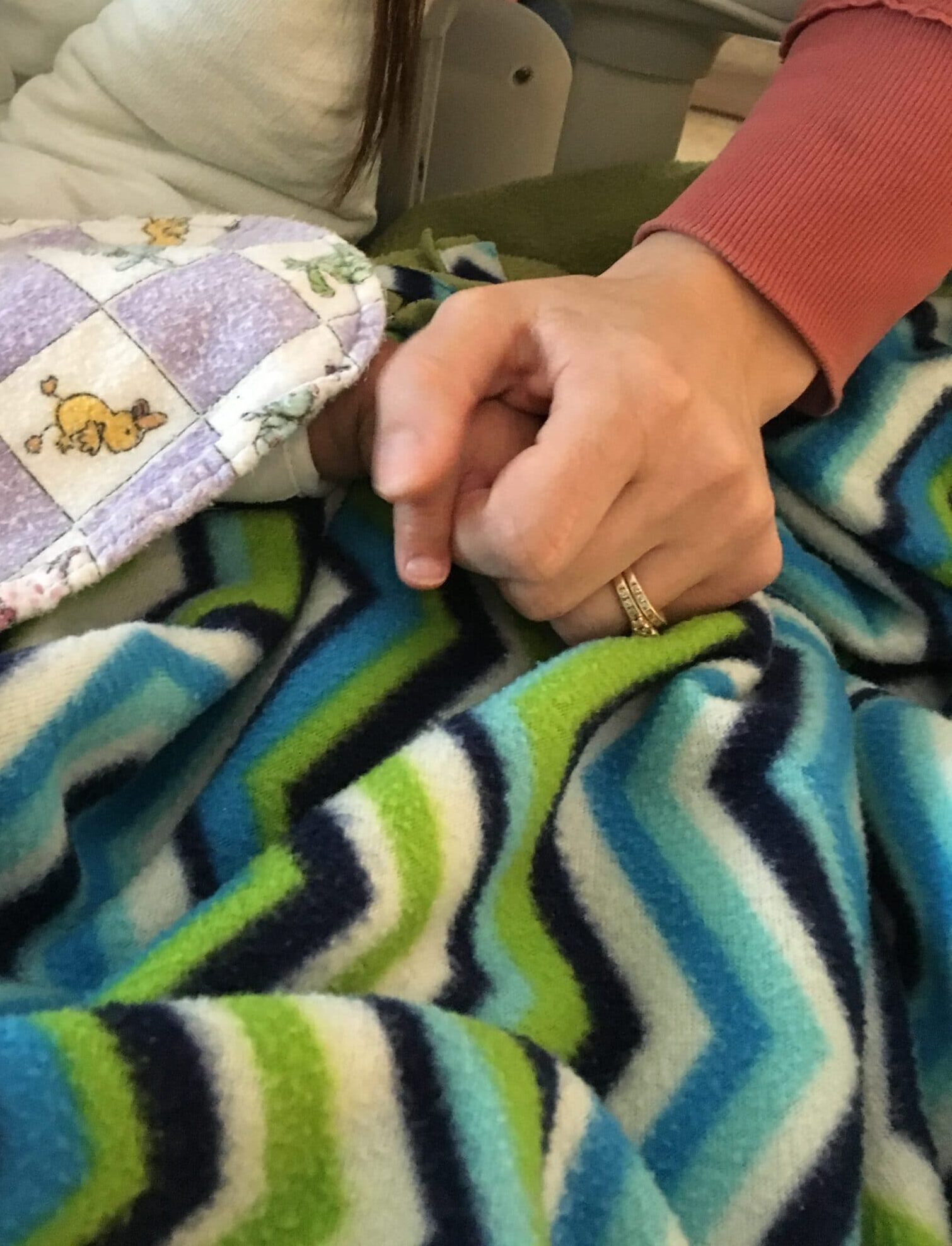 Holding my baby's hand during recovery