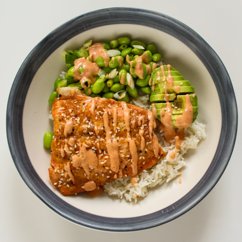 Salmon Sushi Bowl with Edamame Beans and Avocado. Top View.