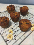 chocolste chip banana bread muffins on a wire rack