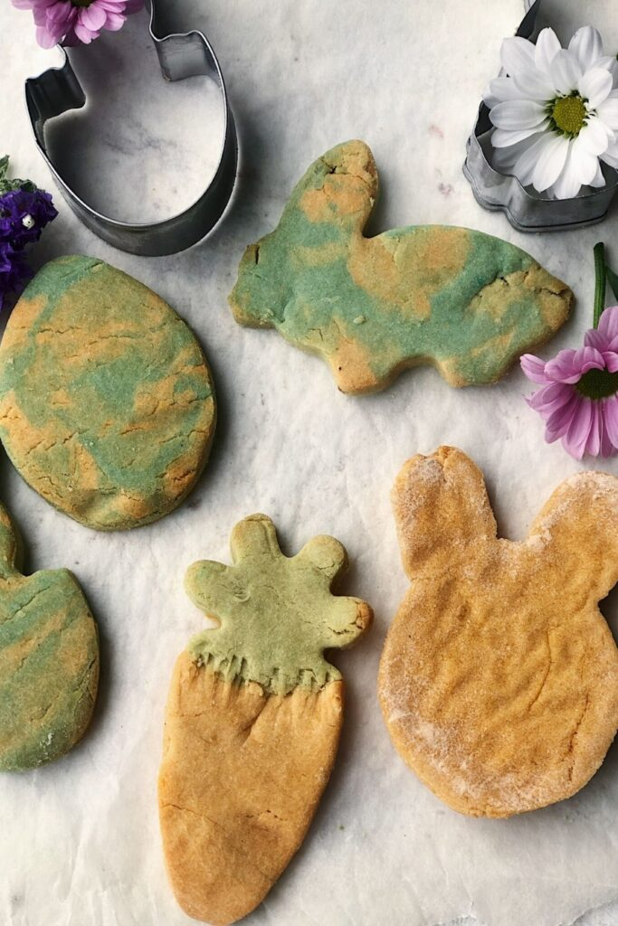 4 marble easter themed cookies with cookie cutters