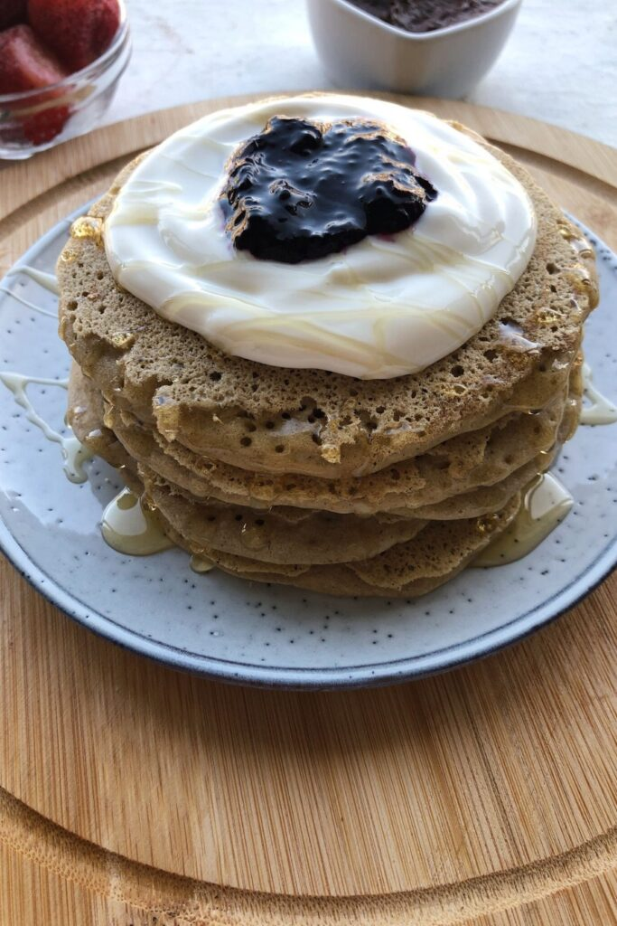 stack of gluten free pancakes with yogurt and blueberries