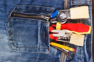 Construction tools in a denim pocket