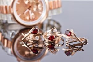 Shiny objects: Golden watch, earrings and rings