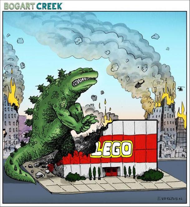 Смішний малюнок про Ґодзіллу. Ґодзілла руйнує місто. Коли почав руйнувати магазин LEGO, то болісно наступив на кубик лего