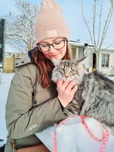 christina and ice in garden norwegian forest cat snow