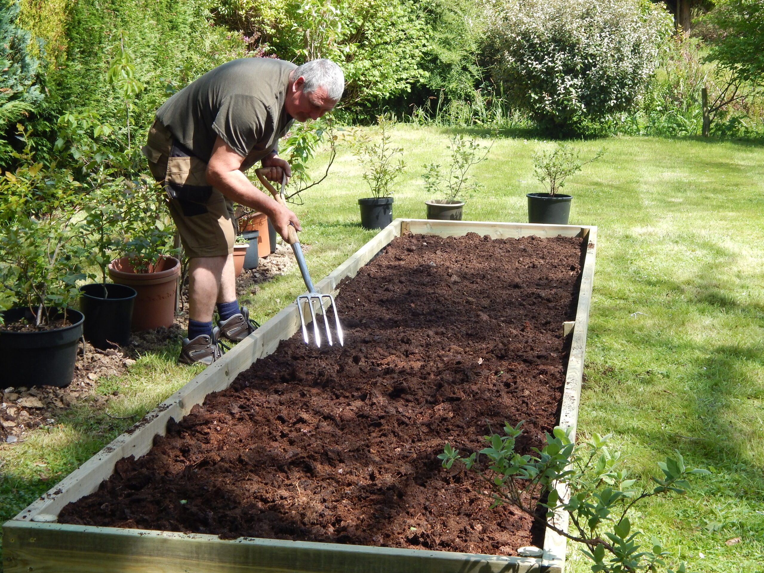 One of the talented gardeners from the Rudgwick Gardens team hard at work preparing a new flower bed.